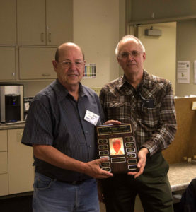 Keith Witney VE7KW presents the  award to Bill Scholey VE7QC